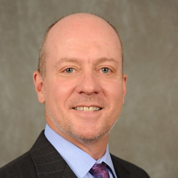 Dr. Mark C. Rom