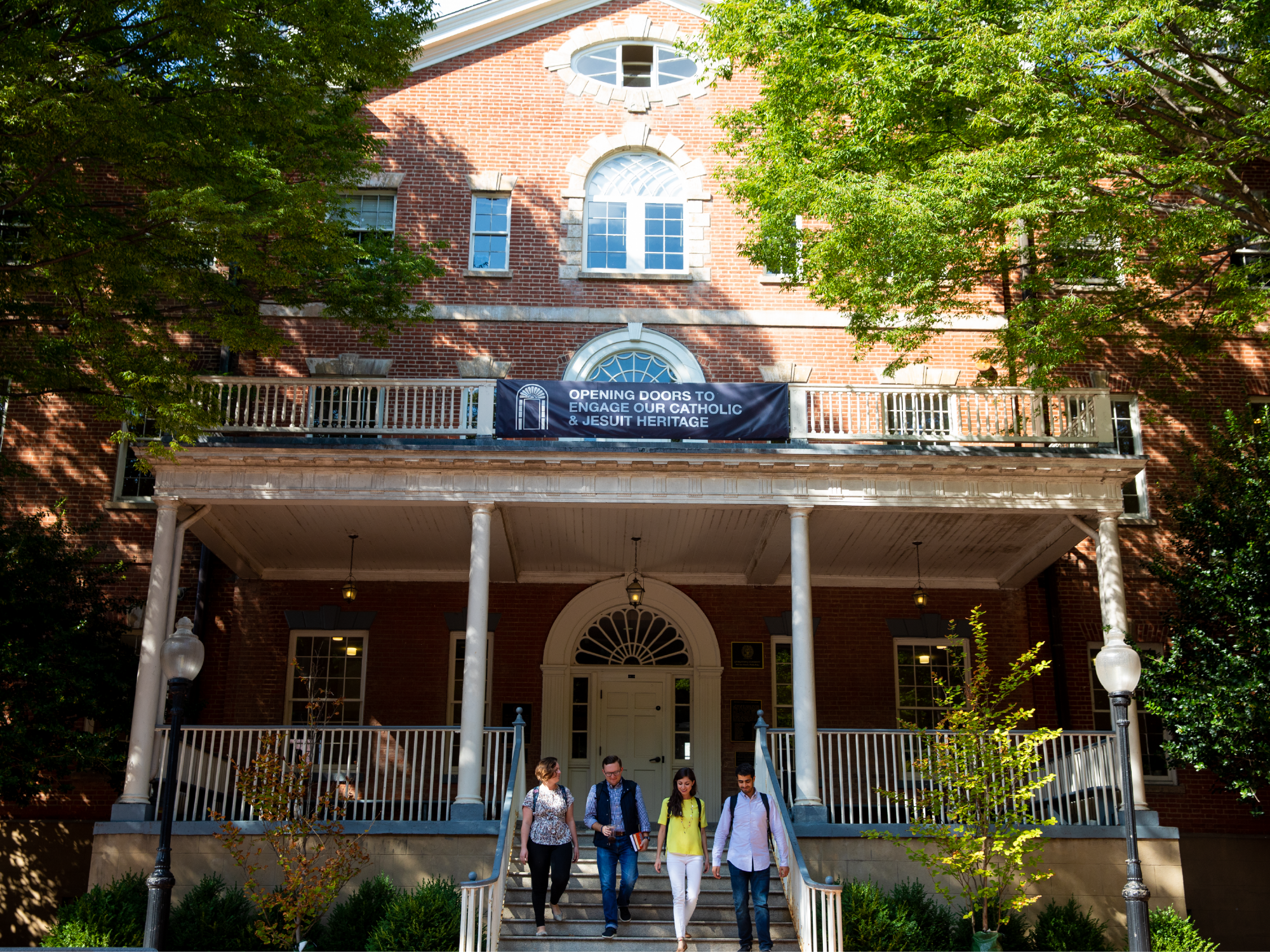 Image of four students walking down the Old North steps