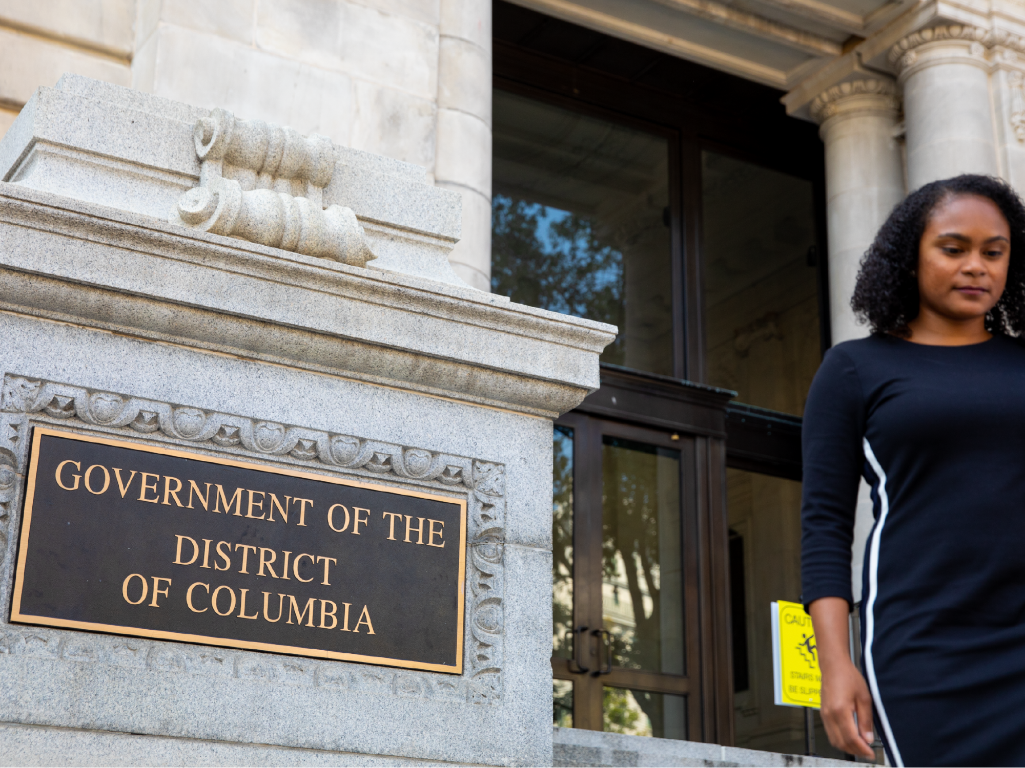 Woman walking down the steps of a government building