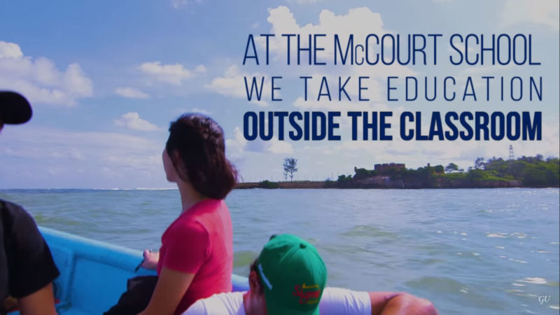 At McCourt We Take Education Outside the Classroom - still image of student son a boat in Central America