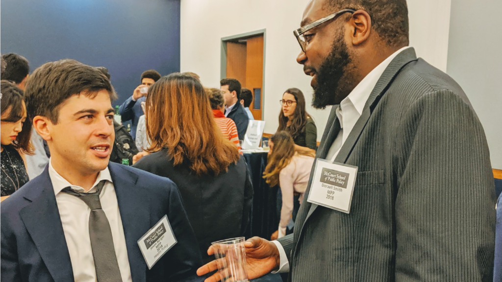 Photo of two alumni speaking during the 2019 annual networking night