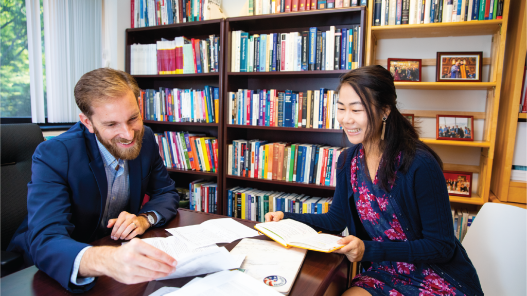 Professor Jonathan Ladd and student Frances Chen during office hours