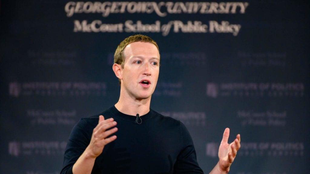 Mark Zuckerberg at podium giving a talk in Gaston Hall