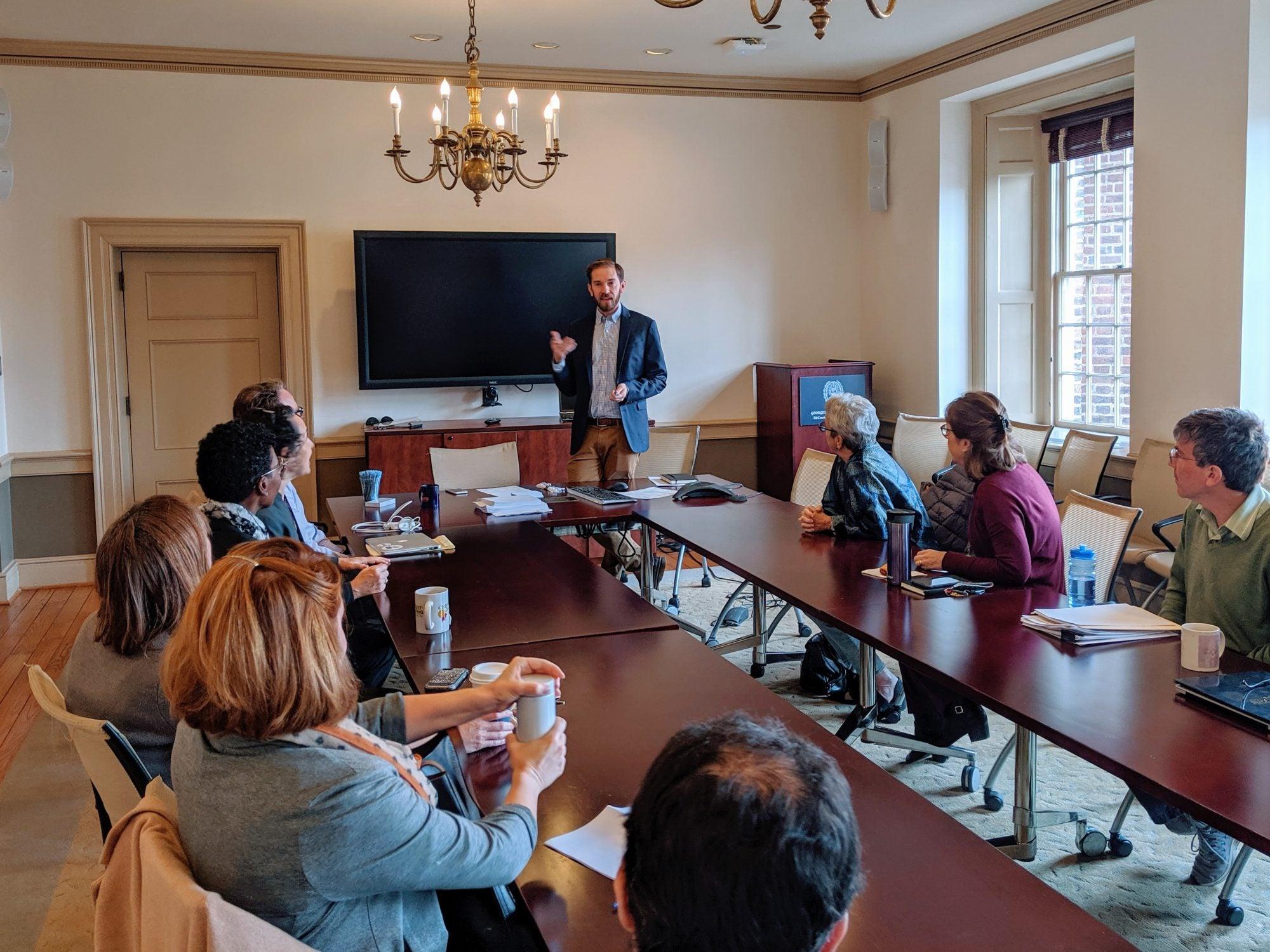 Image of McCourt School Professor Jonathan Ladd giving a presentation during a faculty seminar