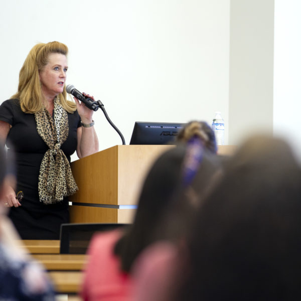 Image of Kendra Davenport speaking at a conference in Virginia Beach