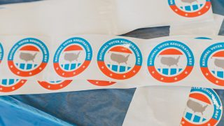 voter registration stickers on a table