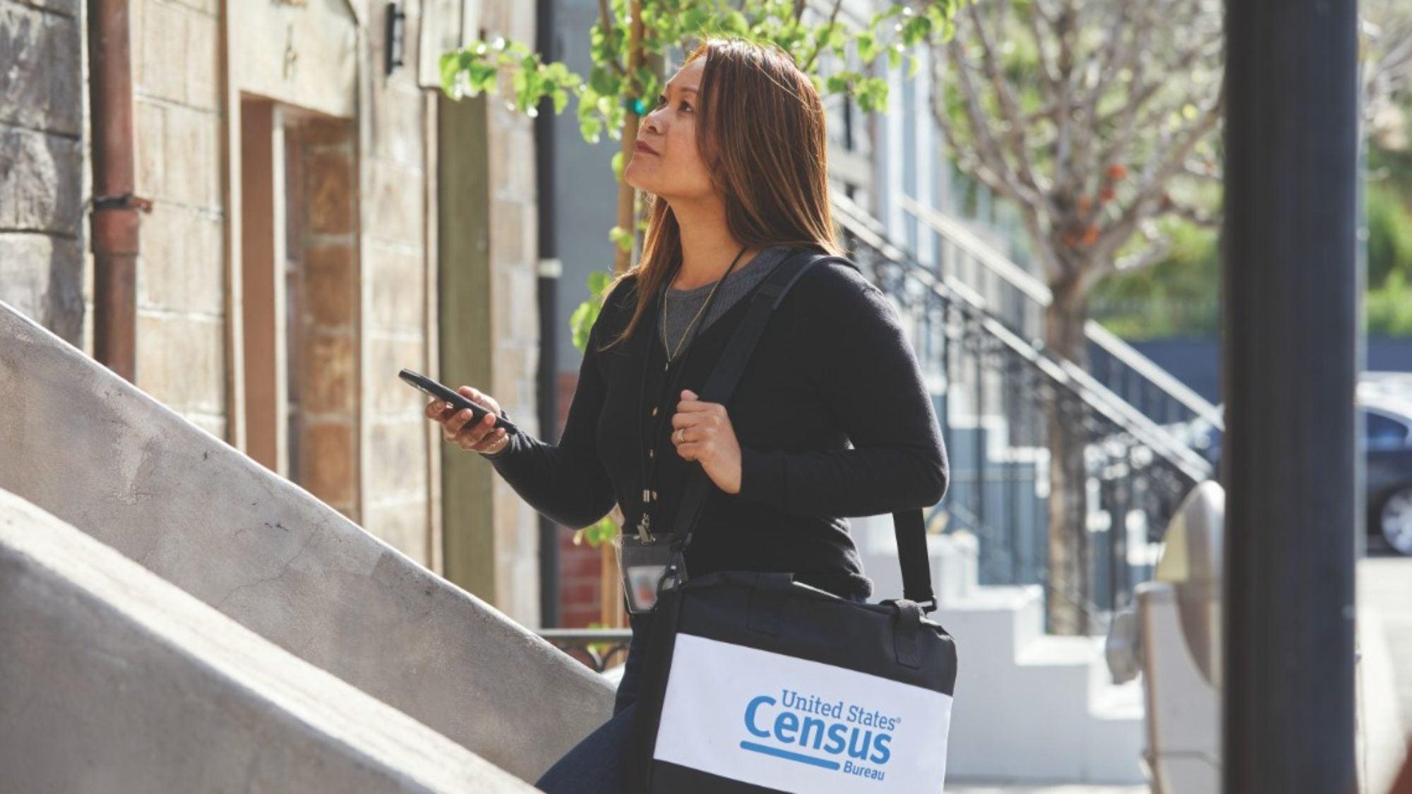 Census worker walking upstairs