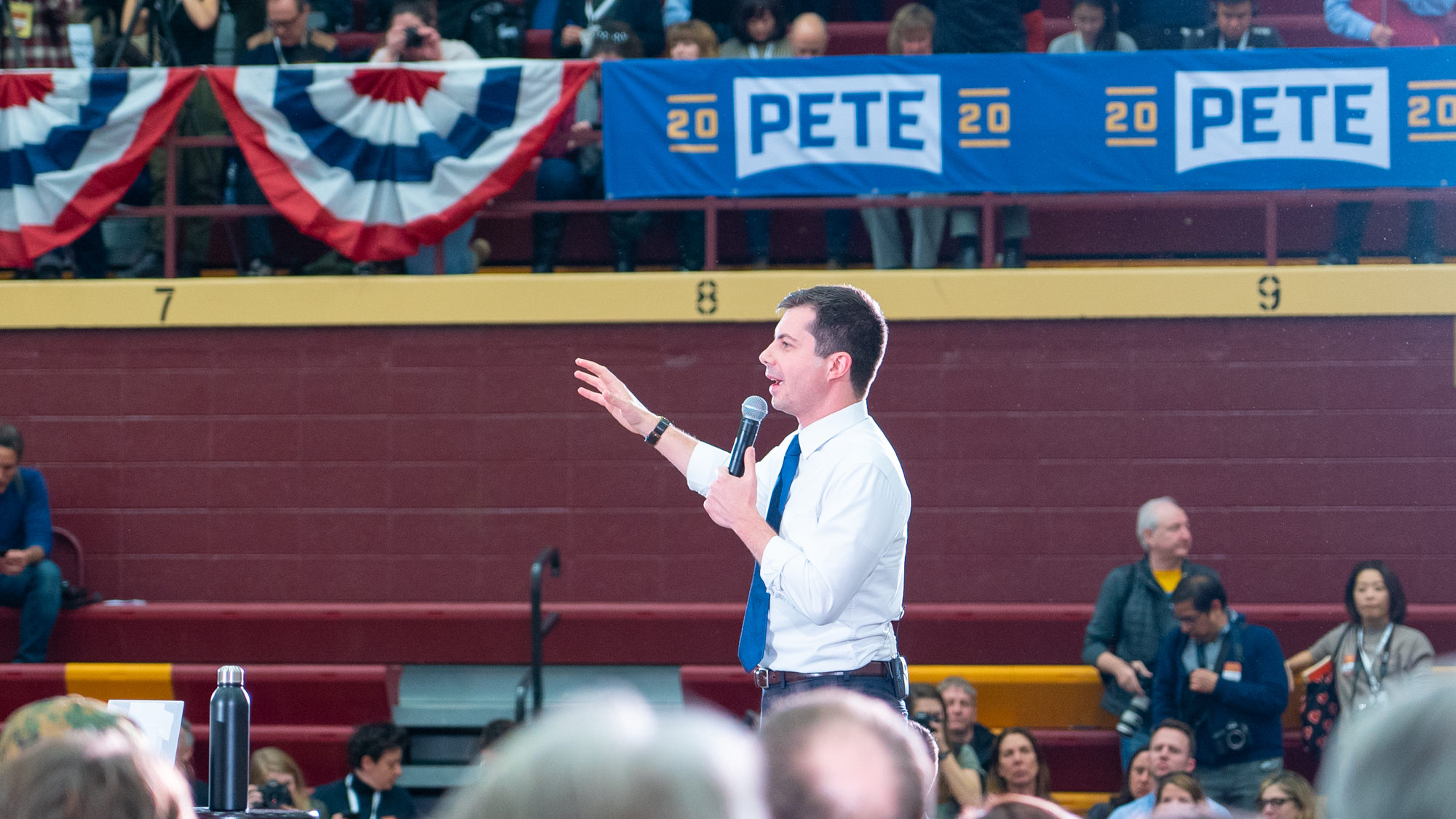 Photo of Buttigieg Speaking On-stage in Iowa