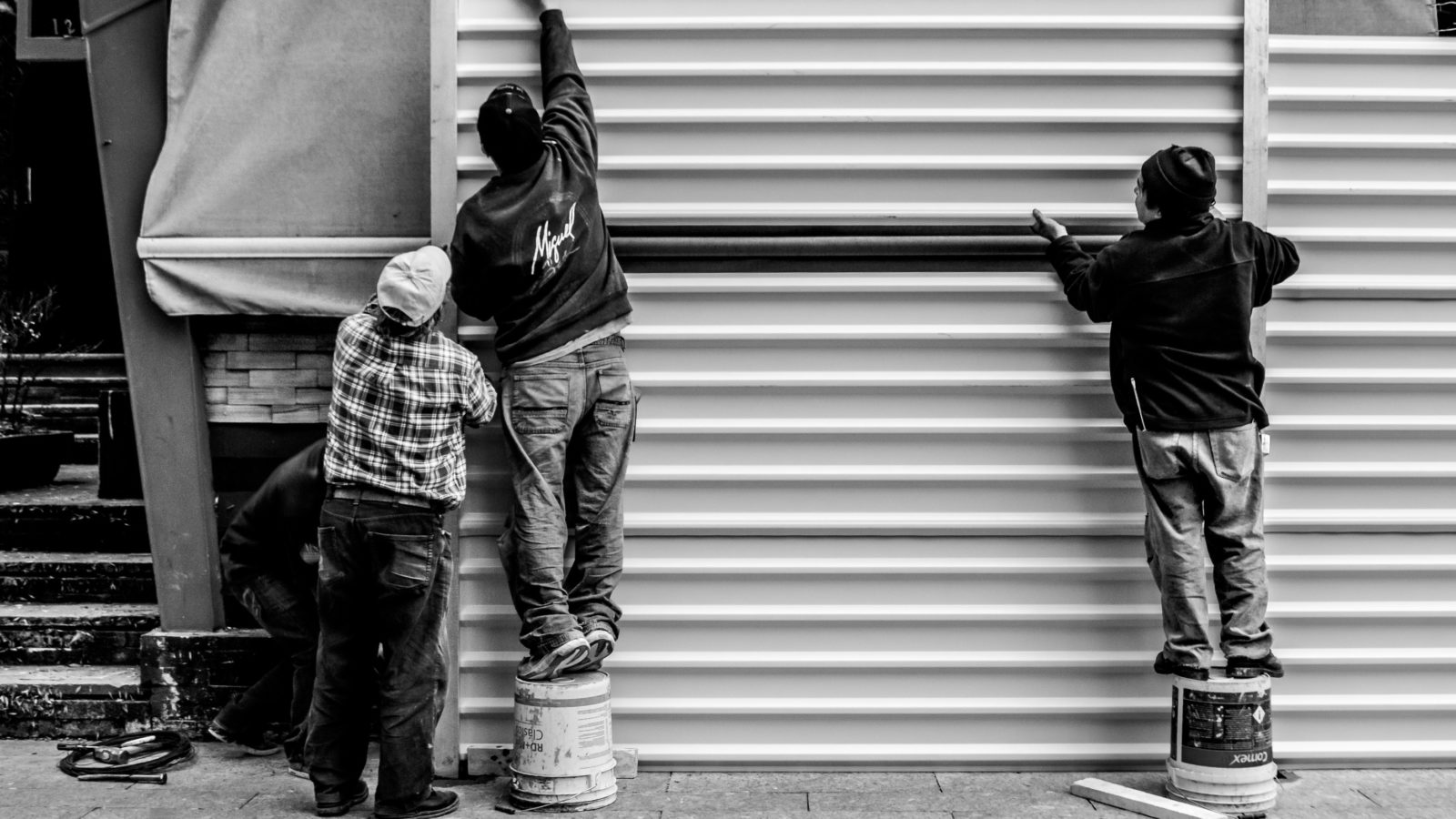 Photo of workers arranging a metal wall