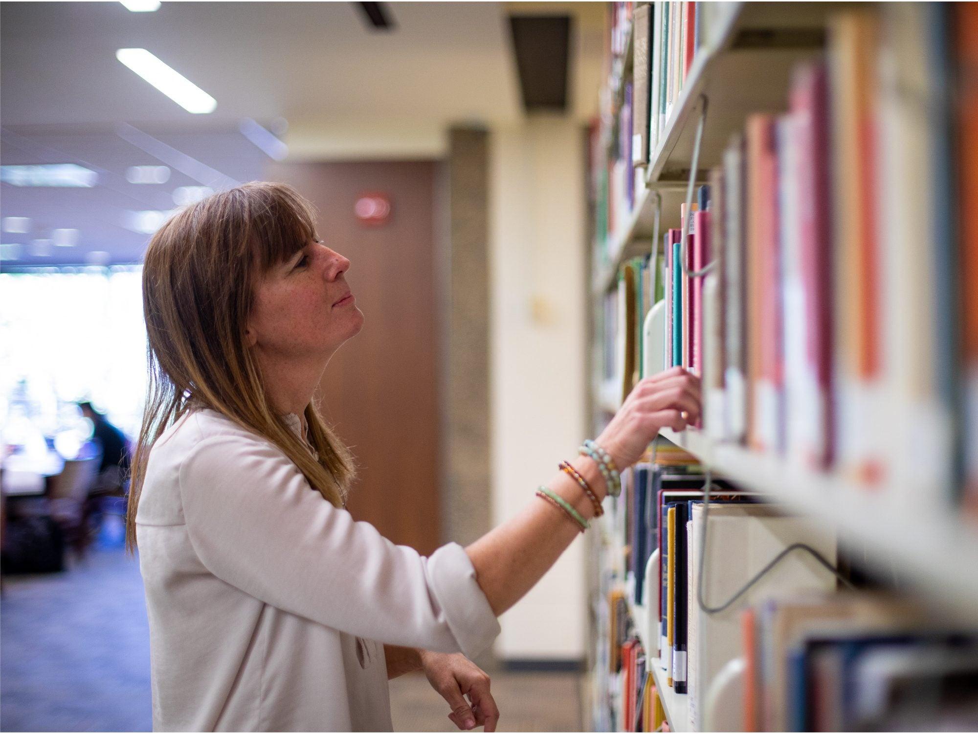 Professor Pam Herd in the library