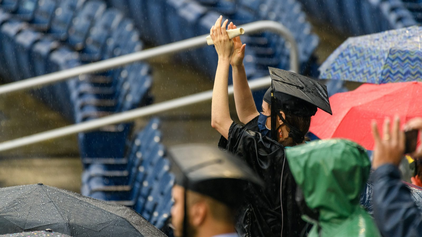 Student sits in the rain at nationals park