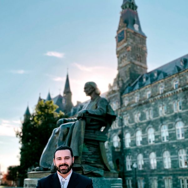 Mauricio Forzan in front of Healy Hall