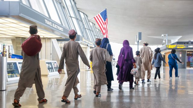 Afghan refugees arriving at an airport